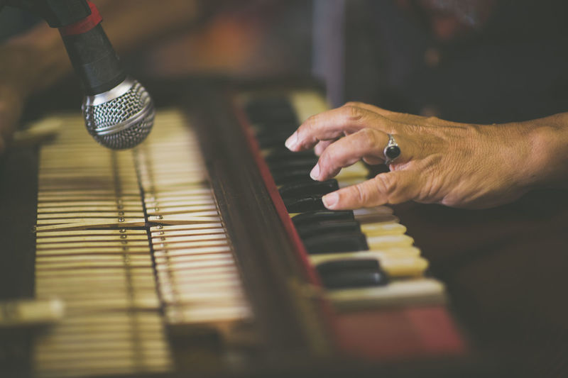 Cropped Image Of Hand Playing Harmonium
