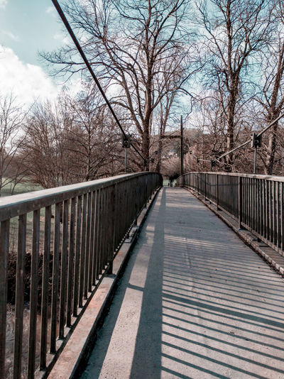 a bridge in Newtown Winter Footbridge Pedestrian Walkway Light And Shadow Tree Bare Tree Footbridge Railing Sky Architecture Built Structure Bridge - Man Made Structure Diminishing Perspective vanishing point The Way Forward Cable-stayed Bridge Suspension Bridge Passageway Walkway Pathway