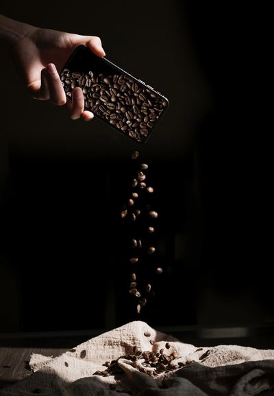 咖啡豆 coffee beans IPhone Beans Coffee Human Hand Hand Human Body Part Holding One Person Indoors  Food And Drink Studio Shot Table Finger Chocolate Black Background