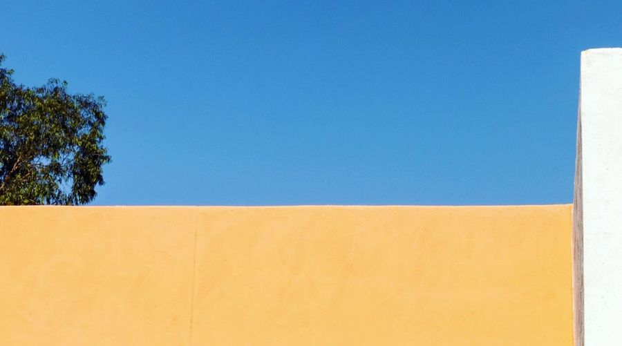 Minimalism Blue Day Copy Space Outdoors Yellow Clear Sky No People Built Structure Architecture Sky