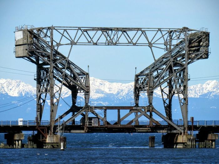 The Trestle with snow capped Olympic mountains. Train Bridge Mountain Range Snowcapped Mountain EyeEmNewHere Built Structure Industry Sky Sea Day Architecture
