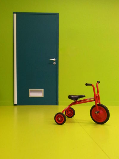 Close-Up Of Tricycle In Green Room
