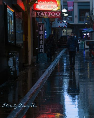 Water Built Structure City Life Person Illuminated Transportation People And Places Rainy Days Check This Out Thinkfull Meanful Inspired Lifestyles Lives Streetphotography City Views Contrast City Building Exterior Waterfront Reflection