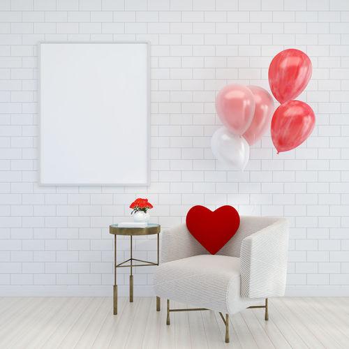 Heart shape on table against wall