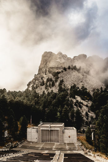 View of castle on mountain against cloudy sky