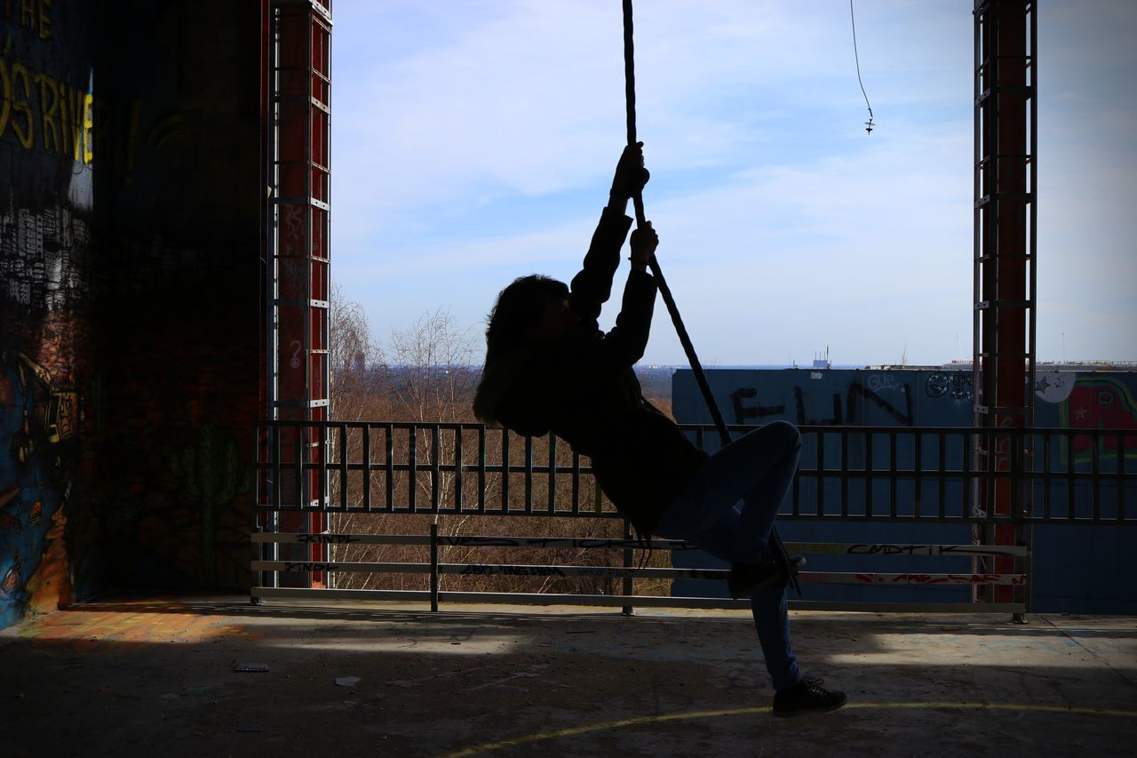 Side View Of Person Swinging On Rope At Teufelsberg