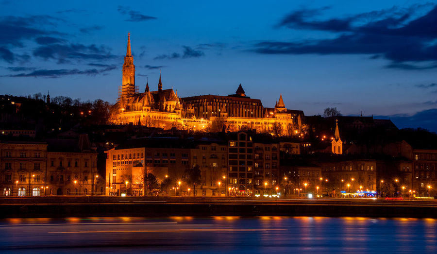 Royal palace or the buda castle and the chain bridge after sunset   in budapest hungary.