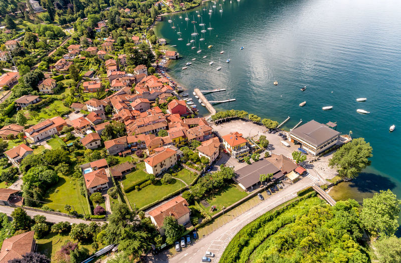 Aerial view of the village and the small harbor of Castelveccana, located on the shore of Lake Maggiore in the province of Varese, Lombardy, Italy Harbor Aerial View Architecture Boats Building Exterior Calde Castelveccana Day High Angle View Lake Maggiore Lake View Landmark Maggiore Lake Nature No People Outdoor Outdoors Portrait Roof Top View Transportation Village Water