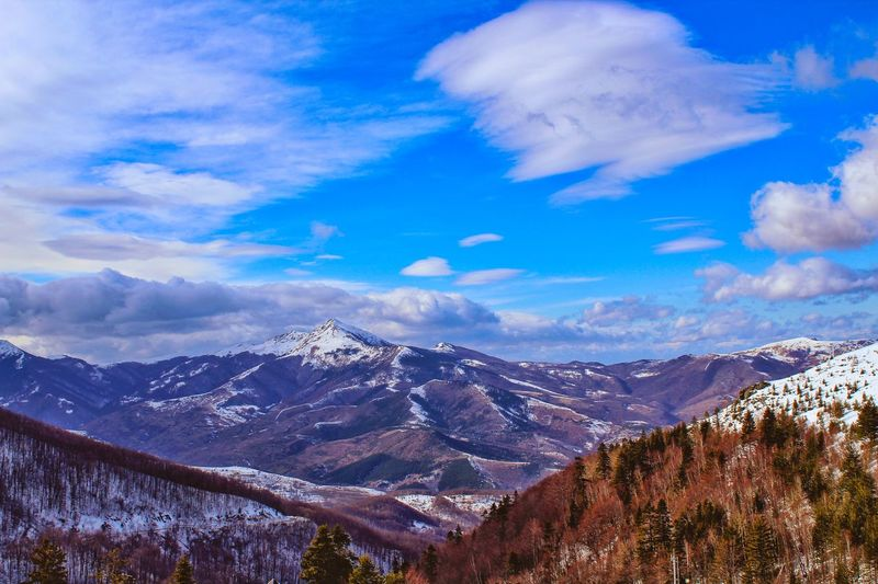 Mountain Mountain Range Beauty In Nature Snow Nature Snowcapped Mountain Sky Cloud - Sky Scenics Winter Outdoors Tree Landscape Blue No People Day Tranquility Cold Temperature The Great Outdoors - 2018 EyeEm Awards