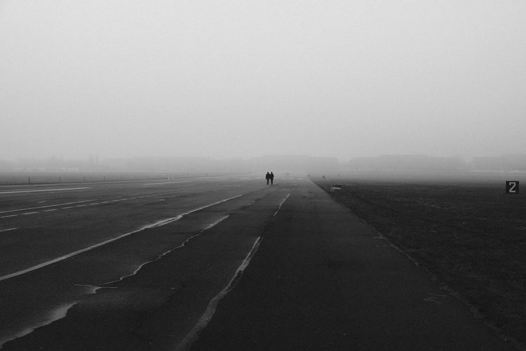 2 Berlin Berlin Photography Endless Foggy Street Road Tempelhofer Feld Walking Together Walking Around Way Of Life Berliner Ansichten Black And White Endless Road Endlessness Foggy Day Number 2 People Photography Tempelhofer Freiheit Together Together Forever Two Two People Walking Way Way Forward