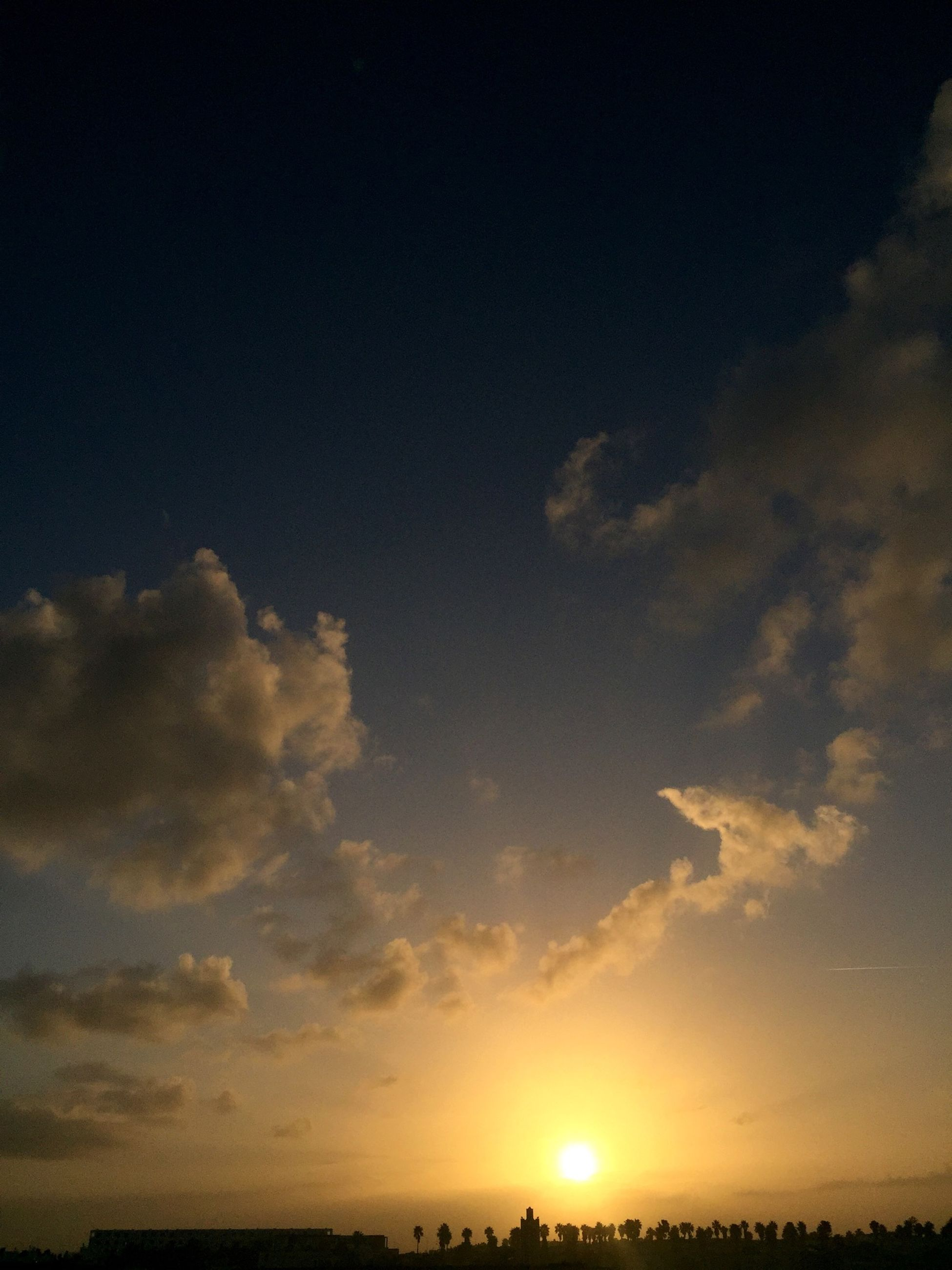 sunset, scenics, tranquil scene, sun, sky, silhouette, beauty in nature, tranquility, orange color, idyllic, nature, cloud - sky, sunlight, landscape, cloud, outdoors, sunbeam, dramatic sky, no people, majestic