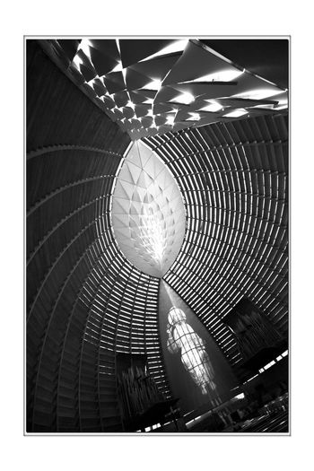 Cathedral of Christ the Light 11 Oakland, Ca. Cathedral Of Christ The Light Roman Catholic Church Architecture Modern Style: Late 20th Century Abstract Architectural Detail Interior Douglas Fir Ceramic Frit, Glass,steel,concrete Former Parrish Home, St. Francis De Sales Cathedral Destroyed In The 1989 Loma Prieta Earthquake New Church Dedicated September 2008 Monochrome_Photography Monochrome Abstract Black & White Black & White Photography Black And White Black And White Collection  Event Center 5,100 Sq.ft. The Image Of Christ In Glory Alter Omega Window