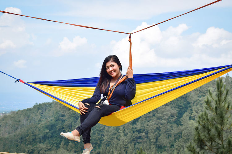 One Person Happiness Sitting Beauty Adult Emotion Smiling Nature Relaxation Beautiful People Women Young Adult Landscape Leisure Activity Rural Scene Swing Positive Emotion Lifestyles Environment Sky