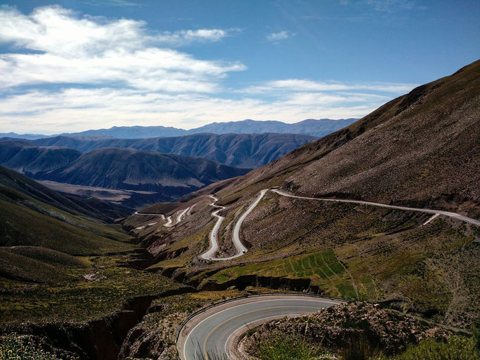 Narrow Road Along Rocky Landscape