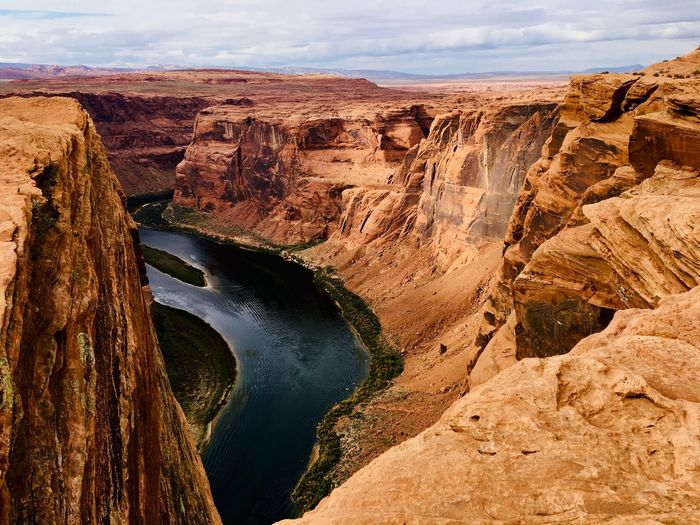Panoramic view of river amidst rock formations against sky