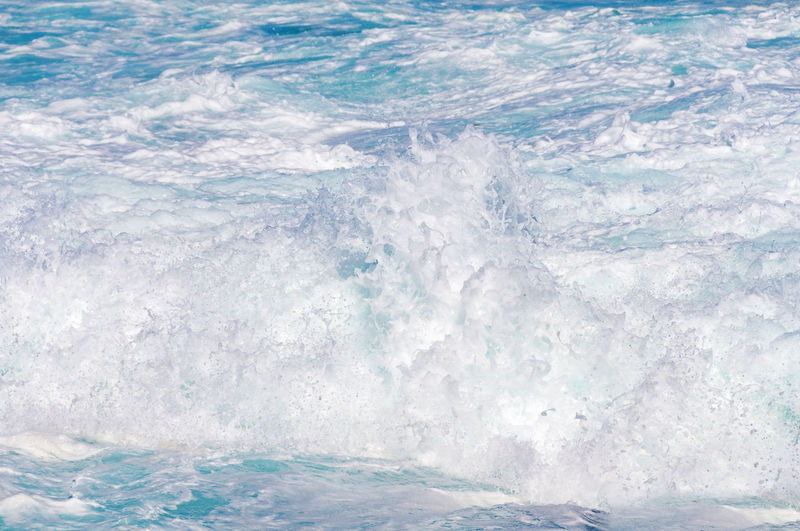 Wave crush with splashes and white foam nature background, texture