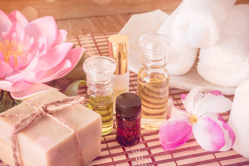 Aromatherapy Aromatherapy Oil Beauty In Nature Beauty Spa Beauty Treatment Body Care Bottle Close-up Day Flower Flower Head Fragility Freshness Health Spa High Angle View Indoors  Nature No People Pampering Petal Pink Color Salt - Mineral Spa Spa Treatment Still Life