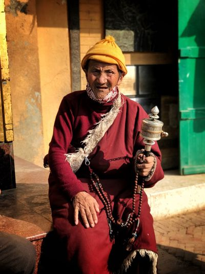 Buddhist devotee Street Photography Nepal Kathmandu Devotee Buddhist Devotee Buddhist Real People One Person Front View Traditional Clothing Three Quarter Length Looking At Camera Holding Portrait Outdoors Smiling Lifestyles Day