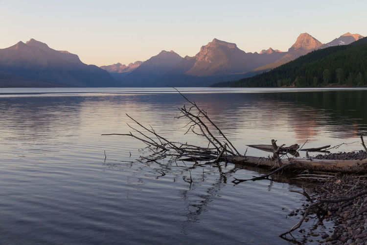 Sunset over Lake McDonald, Glacier National Park, Montana, United States. EyeEmNewHere Lake Mcdonald Reflection Beauty In Nature Glacier National Park Lake Mountain Mountain Range Mountains Mountains And Sky Nature No People Outdoors Reflection Scenics Sky Sunset Tranquil Scene Tranquility Tree Water Waterfront