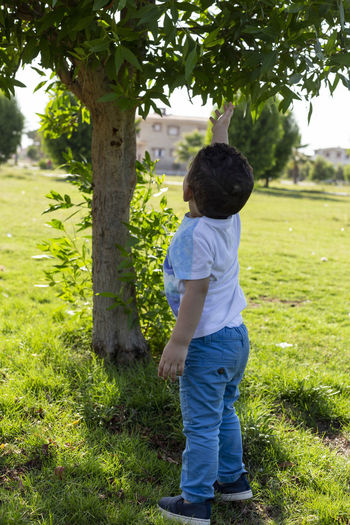 Full length of boy on grassy field