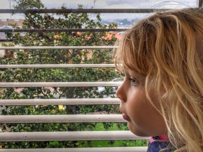 Side View Of Girl By Window At Home