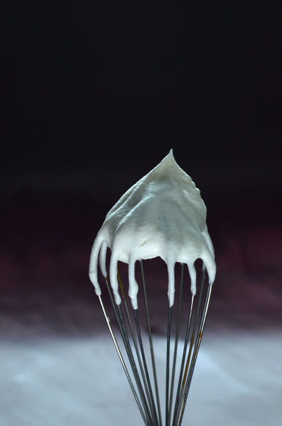 whipped cream on wire wisk Black Background Close-up Dark Fluffy Focus On Foreground Illuminated No People Selective Focus Softness Studio Shot Sweet Sweet Food Tranquility Vignette Whipped Whipped Cream White White Color Wisk