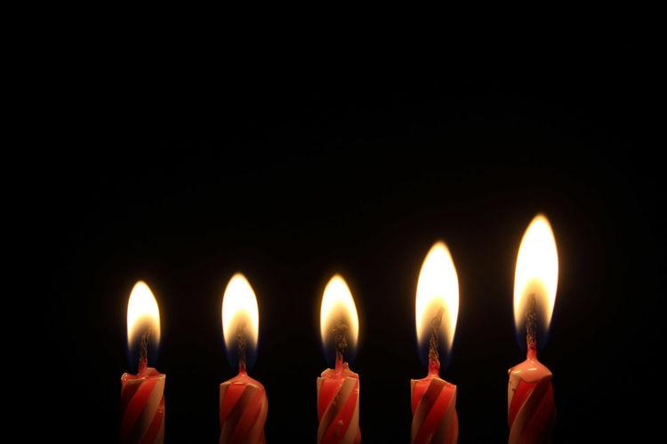 Flame Burning Candle Heat - Temperature Black Background Glowing Red Illuminated Atmospheric Mood Lighting Equipment No People Celebration Spirituality Close-up Yellow Indoors  Studio Shot Diya - Oil Lamp