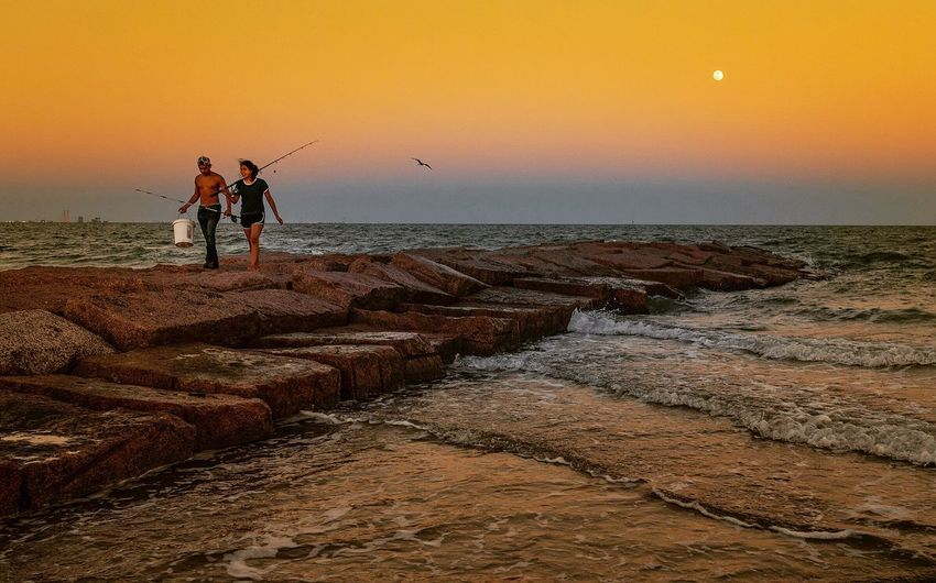 Fishing on the jetty Gulf Of Mexico Sunset Fishing Sea Water Beach Sky Sunset Land Beauty In Nature Horizon Over Water Horizon Togetherness Real People Orange Color Two People Lifestyles Leisure Activity Outdoors