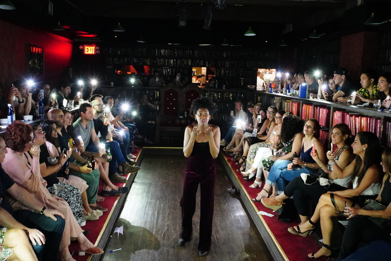 large group of people, group of people, crowd, real people, women, men, adult, night, indoors, sitting, architecture, leisure activity, illuminated, arts culture and entertainment, lifestyles, activity, occupation, nightlife, photographing, waiting