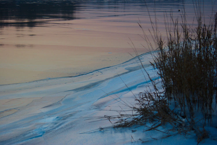 River View Sky Reflection Tranquility Winter Scenery Beauty In Nature Cold Temperature Frozen Nature Frozen River Grass Lake Nature Outdoors Reflection River Bank  Scenics Sky Gradient Sunset Colors Tranquil Scene Winter