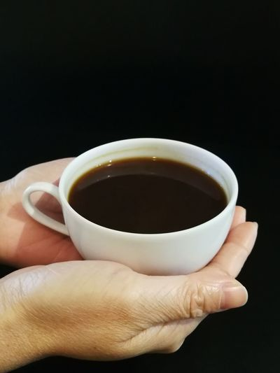 holding a cup of long black coffee Human Hand Black Background Nail Polish Drink Tea - Hot Drink Fingernail Holding Teabag Studio Shot Human Finger Black Coffee Coffee Coffee Cup Hot Drink Coffee - Drink Espresso Cappuccino Latte Beverage Black Tea Afternoon Tea
