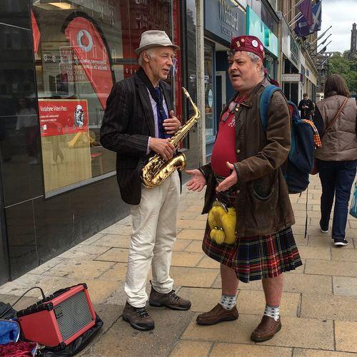 Edinburgh people Princes Street Edinburgh Kilt Scottish Men Music City Adult Two People Musical Instrument Clothing Arts Culture And Entertainment Real People Street Full Length Performance Standing Street Performer Saxophone People