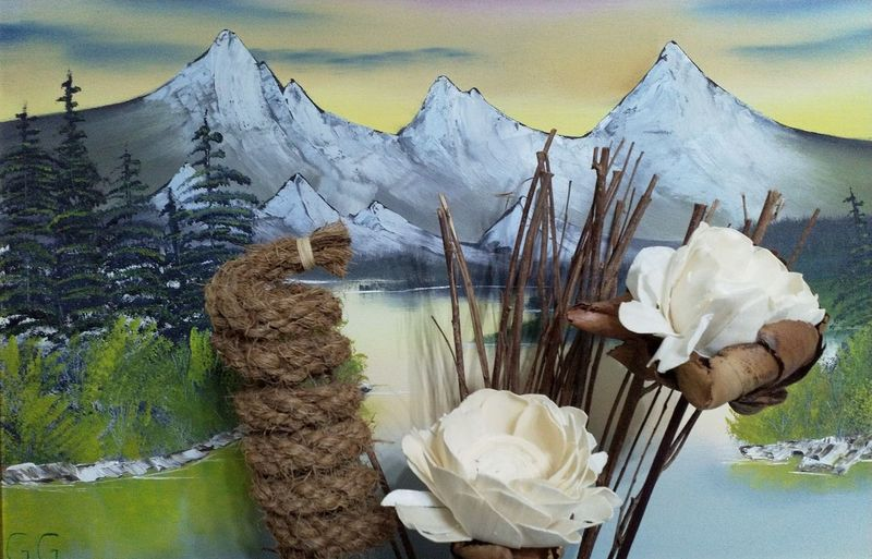 Close-up of white rose on snow covered mountain