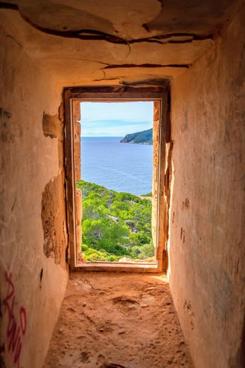 countryside of sant elm, majorca, spain Window Land Indoors  Nature Sea Scenics - Nature Water Sky Travel Architecture Day No People Beach Horizon Cloud - Sky Tranquility Landscape Travel Destinations Horizon Over Water
