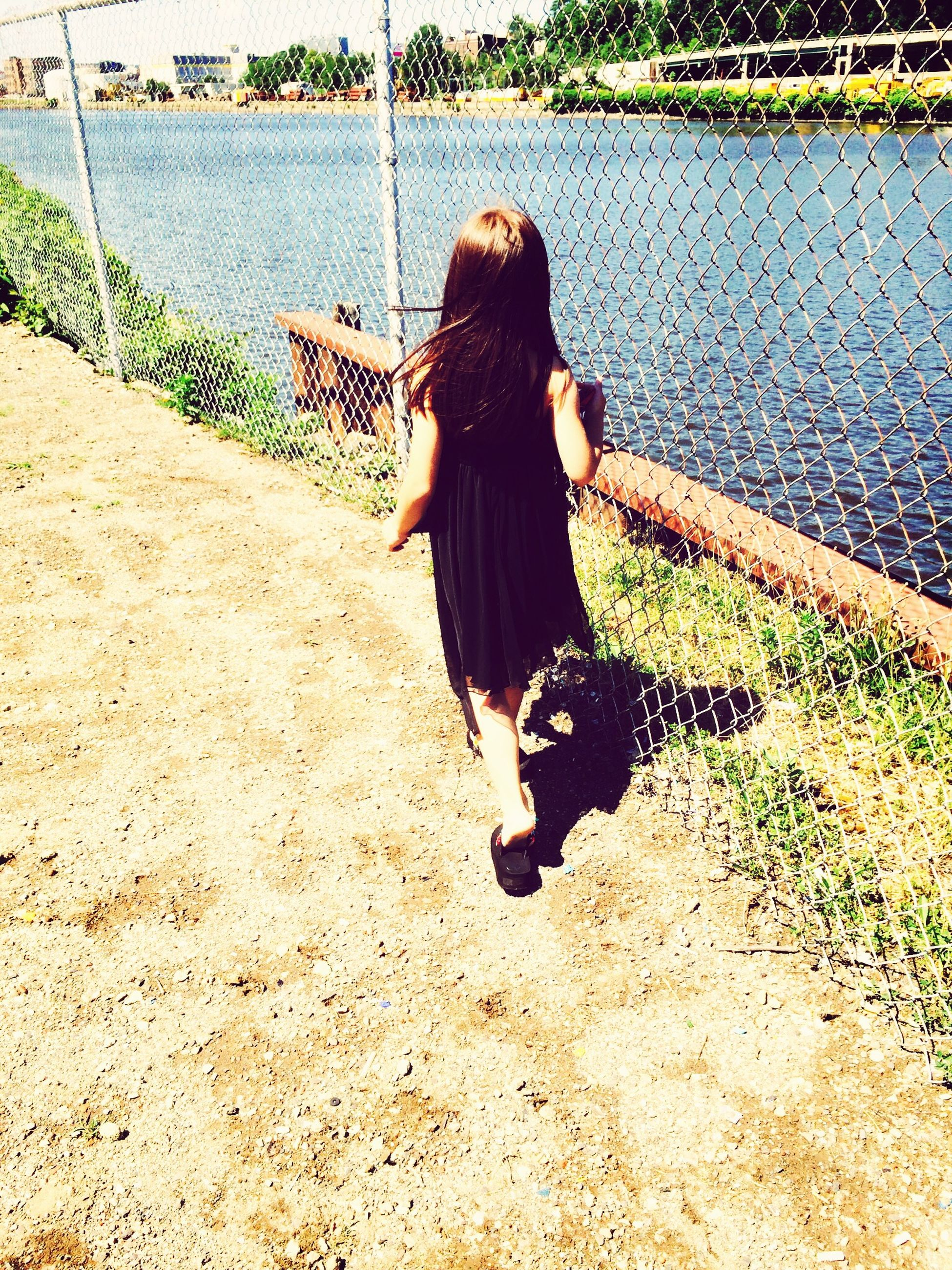 lifestyles, leisure activity, full length, rear view, casual clothing, person, standing, long hair, shadow, young women, high angle view, walking, sitting, sunlight, outdoors, day, water, plant