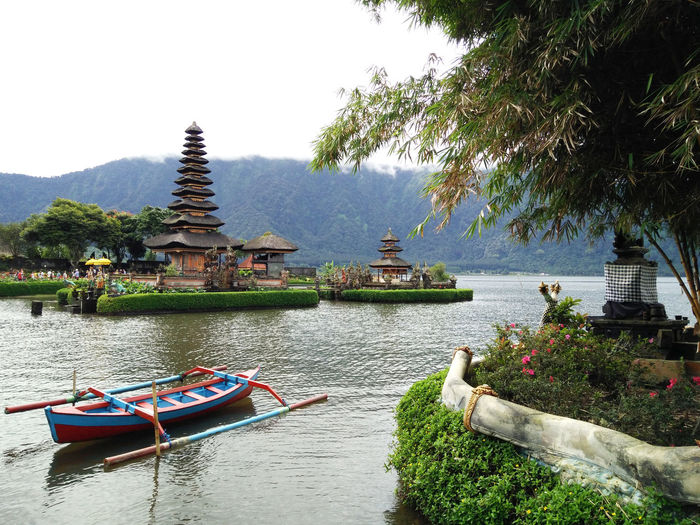 Architecture Beauty In Nature Boat Built Structure Day Green Color Growth Idyllic Mountain Nature No People Outdoors Plant Rippled Scenics Sky Tourism Bali, Indonesia Bedugul Travel Destinations Tree Water