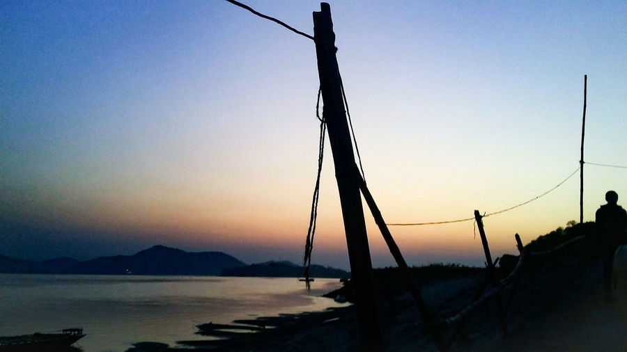 Silhouette Water Sky Outdoors Beach Fishing Net Beauty In Nature Sunset Sea No People Day Nature Beauty In Nature Nature