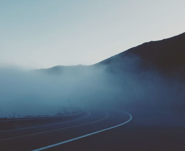 Mountain Fog Road Speed Winding Road Mountain Range Outdoors Car Sports Track Light Trail Transportation Curve Landscape No People Nature Road Trip Mountain Road Adventure Winter Illuminated