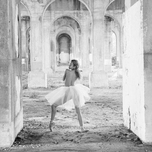 Shirtless Ballet Dancer Wearing Tutu Standing In Abandoned Building