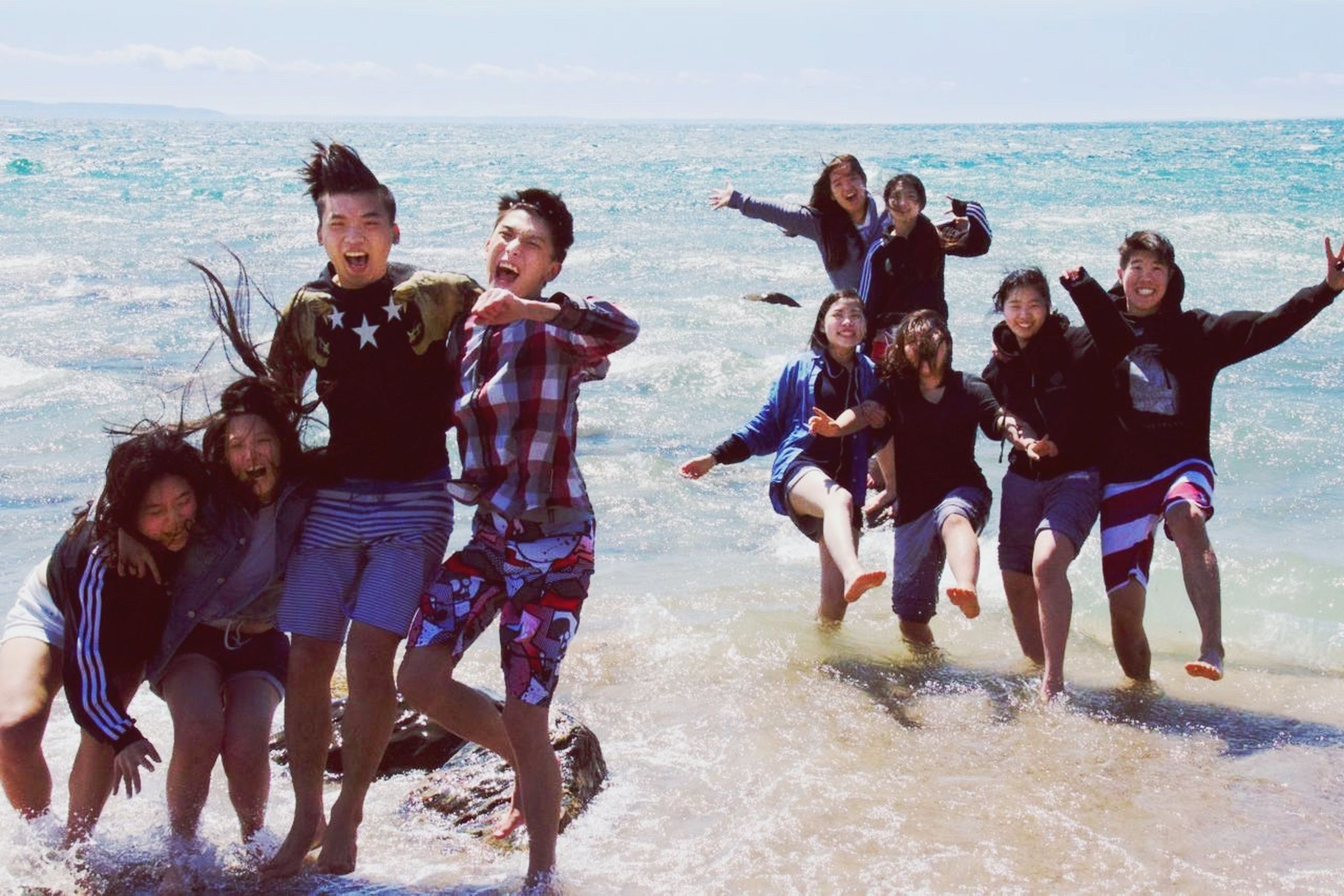 sea, beach, water, lifestyles, leisure activity, togetherness, vacations, shore, horizon over water, men, sand, enjoyment, bonding, summer, large group of people, person, friendship, fun, wave
