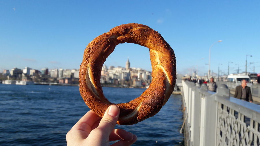 💙Simit Galata Tower Galatakulesi Nofilter Human Hand El Cityscape Sky Sea Human Body Part Clear Sky Water City Sea And Sky EyeEm Best Shots EyeEm Bluesky Foodporn Food Street FoodShades Of Blue Istanbul Turkey The Street Photographer - 2017 EyeEm Awards Been There. Stories From The City