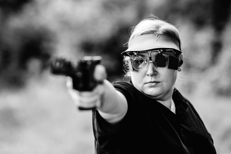 Woman With Pistol On Sport Shooting Training Shooting Pistol Sport Shooting Gun Target Weapon Shooting A Weapon Practicing Sports Training Training Female Woman Outdoors Barrel Competitive Sport Competition Protective Eyewear Handgun Concentration Technique Aiming Equipment Black And White Black White