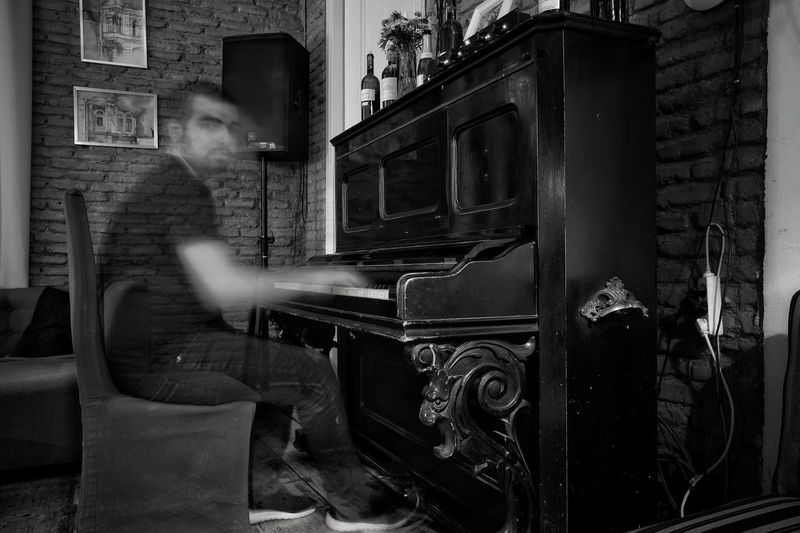 "Be famous and play like ghost in ""Famous Bar"". One Person Old-fashioned Indoors  One Man Only Young Adult People Photodeme Fujilook Ghost Piano Blackandwhite Black & White Famous Playing Piano first eyeem photo AI Now"