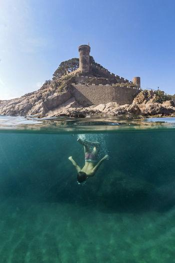 Full length of boy diving in sea