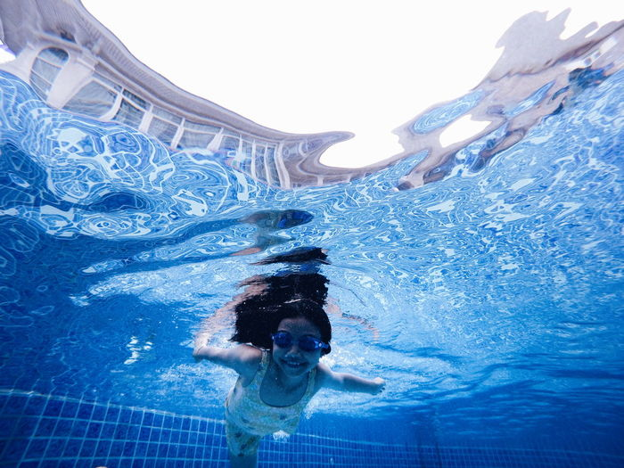 Full length of girl swimming in pool