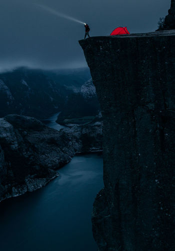 Night watch. Adventure Beauty In Nature Camping Dark Dengler Fjord Flashlight Hike Matthias Mountain Mountaineering Mountains Night Night Photography Nightlife Norway Norway🇳🇴 One Person Outdoors Preikestolen Pulpit Rock Snapshopped Storm Tent Camp