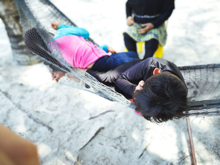 Pulau Redang, Terengganu, Malaysia. Real People Child Lifestyles Day High Angle View Childhood People Females Leisure Activity Women Girls Outdoors Nature Casual Clothing Sitting Full Length Clothing Males  Innocence Warm Clothing Hood - Clothing