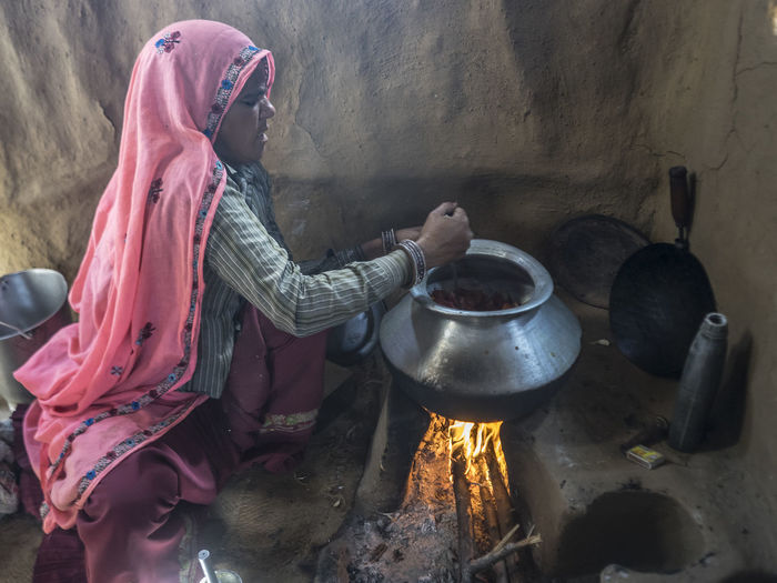 A woman from Rusirani Village cooking for her family Rusirani_village Cooking At Home Traditional Culture Firewwod People Nature Sacred Lady Rural India One Person Cooking Pots Fire