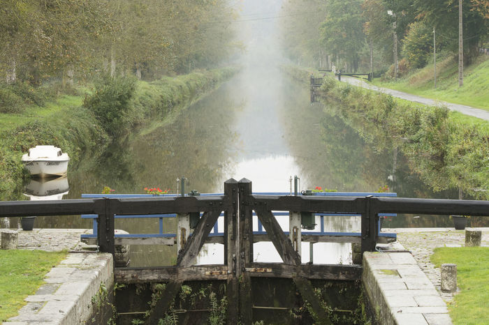 Autumn Canal Towpath Path Reflection Tree Wood Beauty In Nature Boat Canal Path Day Growth High Angle View Lock Gates Mechanism Mist Misty Morning Nature No People Outdoors Railing Sky Timber Tree Water Waterfront