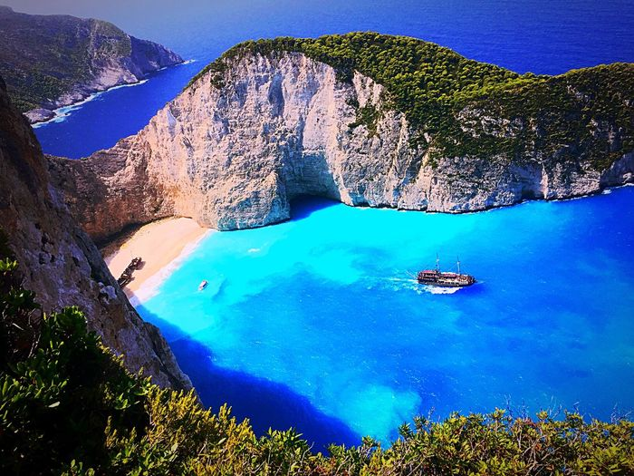 Navagio beach Paradise Beach Beauty In Nature Water Rock - Object Mountain Scenics Nature Blue Beauty In Nature Outdoors No People Landscape Sea Cliff Nautical Vessel Day Sky Perspectives On Nature